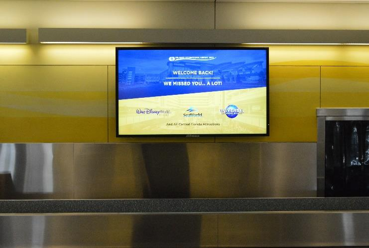 Press Release - Baggage Claim Welcome Back Signage