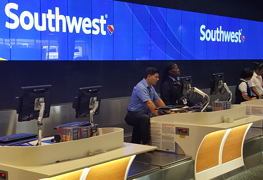 Check-in desks and backwall signage